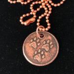 three paw copper charm